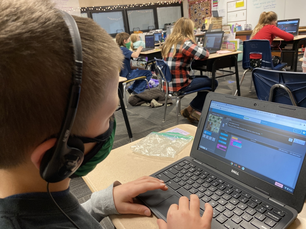 4th grade student uses a Minecraft platform from code.org to learn coding skills.