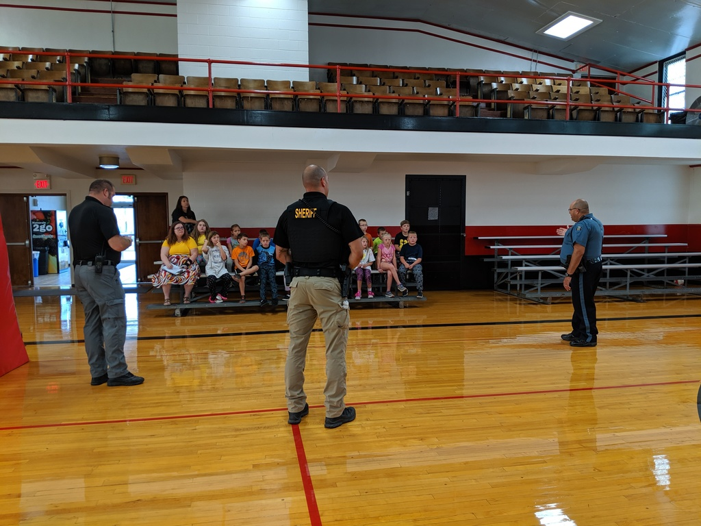 Chief Halfhill, Deputy Come and Trooper Brown talk law enforcement.