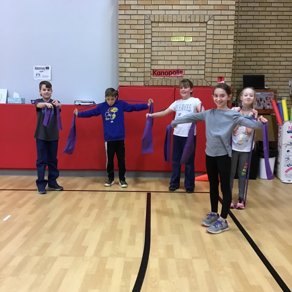 Using resistance bands to strengthen and stretch.